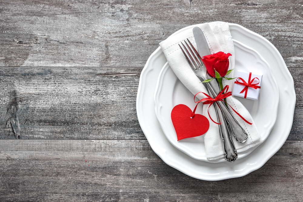 A Silver Fork, Knife, and stunning red rose