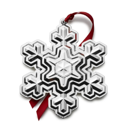 The 2021 Gorham Snowflake ornament in sterling silver with red ribbon.