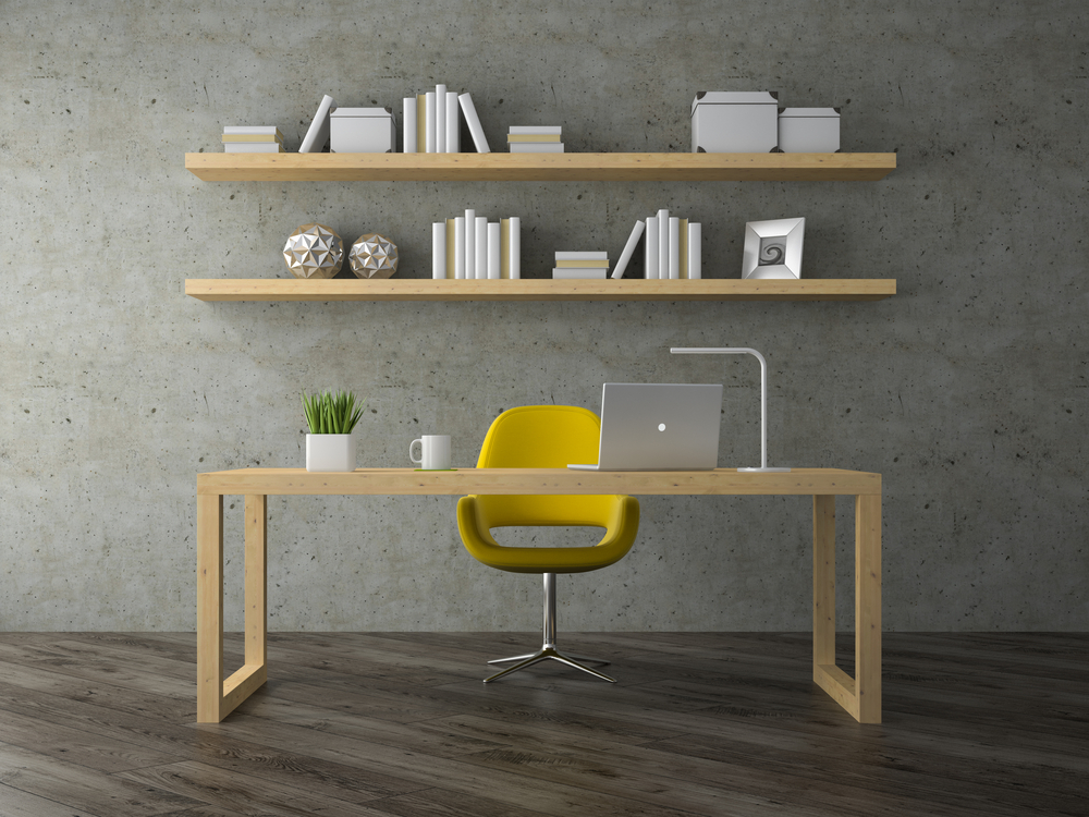 Scandinavian inspired office with cement wall, bright yellow chair