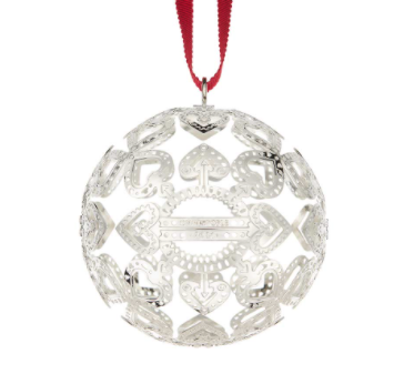 silver Christofle ornament hanging on red ribbon